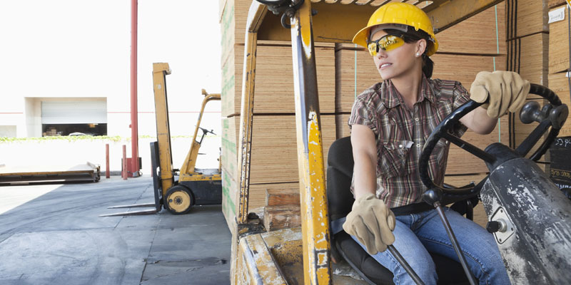 Business-is-GREAT-Woman-operating-fork-lift-truck
