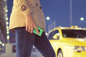 Woman at airport taxi rank