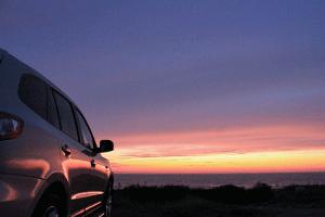 Car overlooking sunset