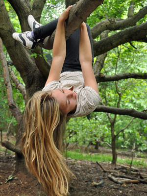 Girl-climbing-tree at Forest School