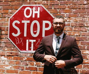 Man-standing-in-front-of-stop-sign