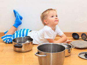 Little boy playing with pans