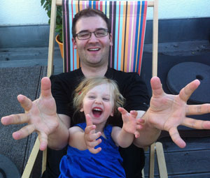 Father and daughter in deck chair