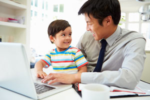 Father and son at laptop