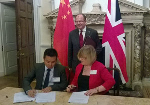 Annie Barr signing an agreement overseen by Minister for Life Sciences, George Freeman