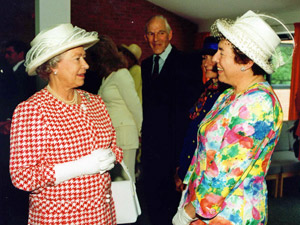 Dame Stephanie with The Queen