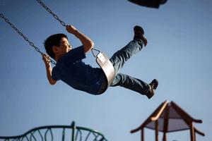 boy-on-swing
