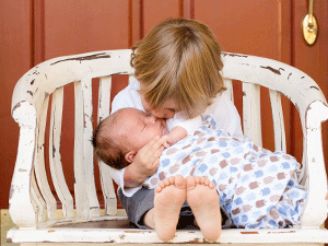 brother caring for baby