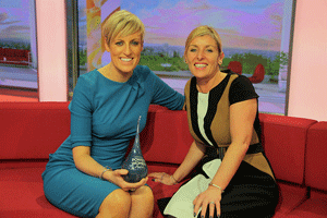 Steph McGovern being presented with her Northern Power Women Award by Simone Roche
