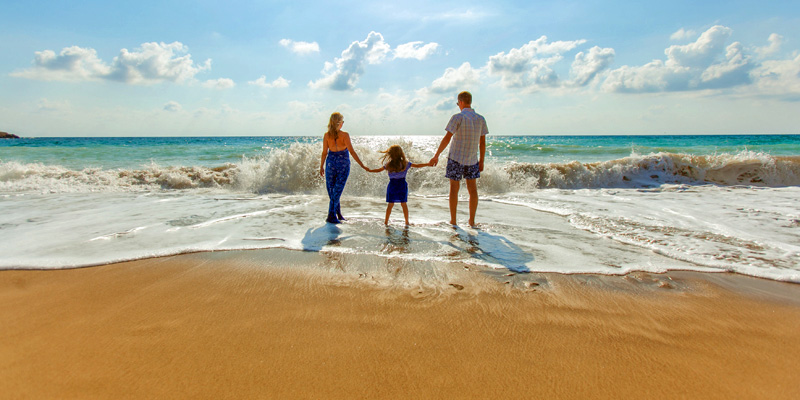 Parents with daughter on beach