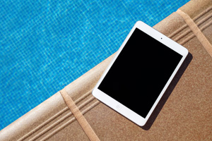 iPad by swimming pool