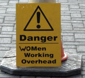 Women working overhead sign