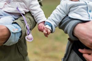 Parents holding babies