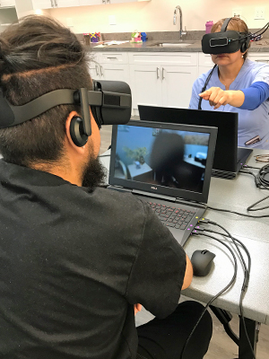 A man and a woman wearing Embodied Labs vrtual reality headsets